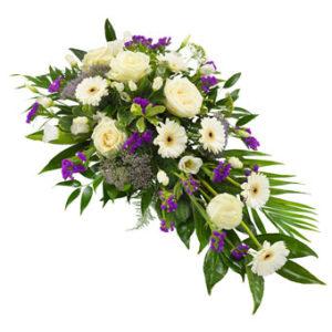 Rouwarrangement wit en lila
